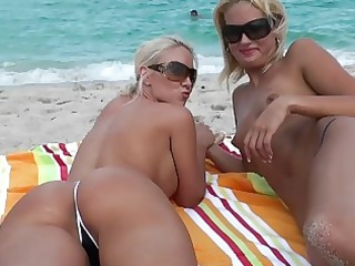 lesbian blondes at the beach licking pussy