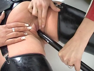 lesbo bdsm latex two doms chastise a sub
